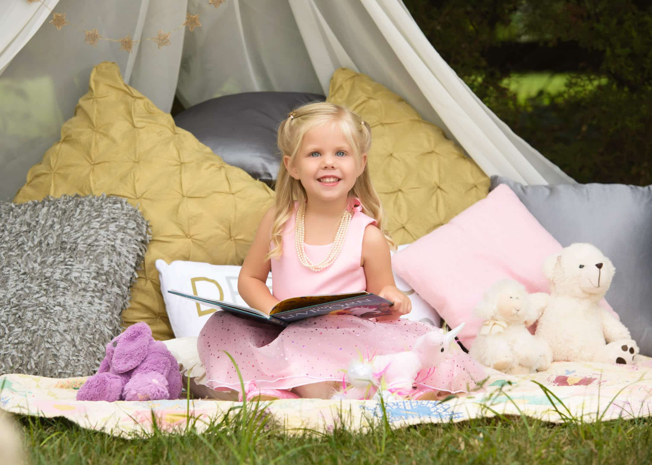 child portrait outdoor tent reading